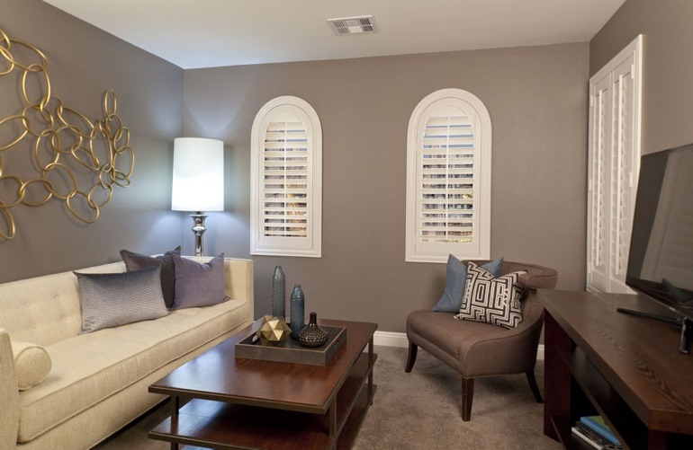 Salt Lake City family room with arch plantation shutters.