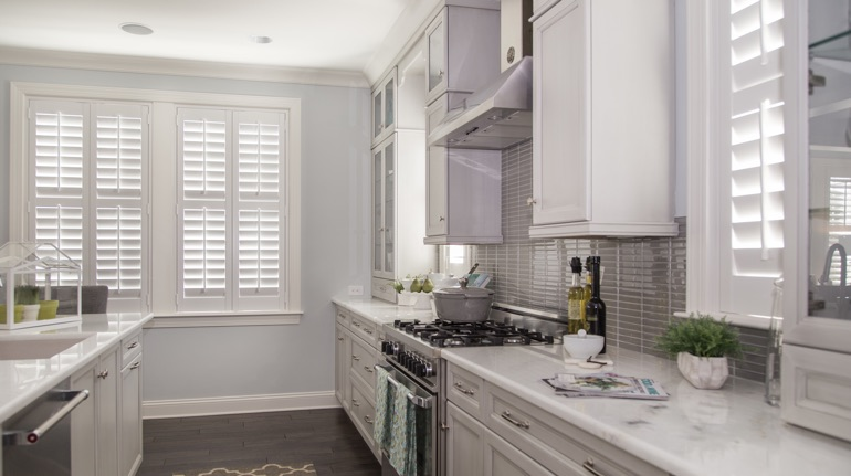 Polywood shutters in Salt Lake City kitchen with modern appliances.