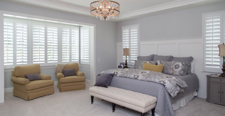 Plantation shutters in Salt Lake City bedroom.