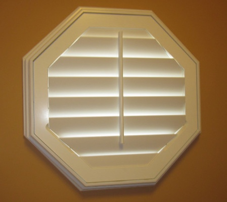 Salt Lake City octagon window with white shutter