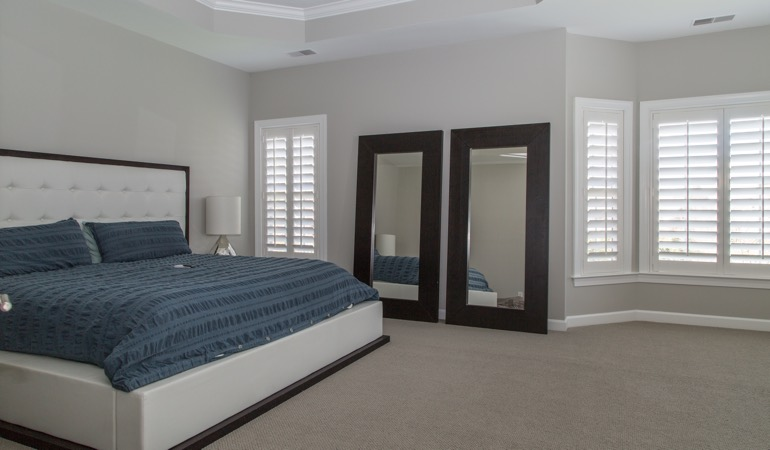 Polywood shutters in a minimalist bedroom in Salt Lake City.