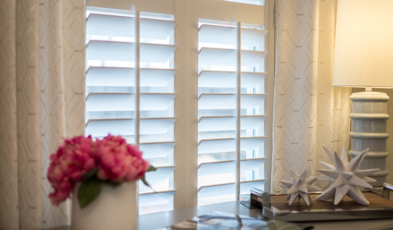 Plantation shutters by flowers in Salt Lake City
