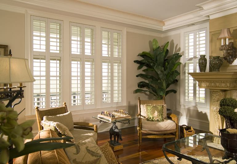 Lounge interior with hardwood floors and plantation shutters.