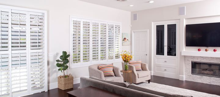 Salt Lake City living room in white with plantation shutters.