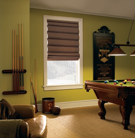 Roman shades in Salt Lake City game room with green walls.