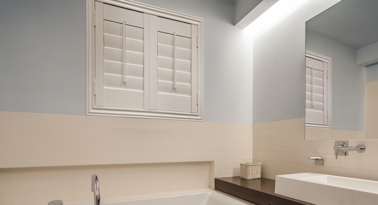 Studio waterproof shutters in Salt Lake City bathroom.