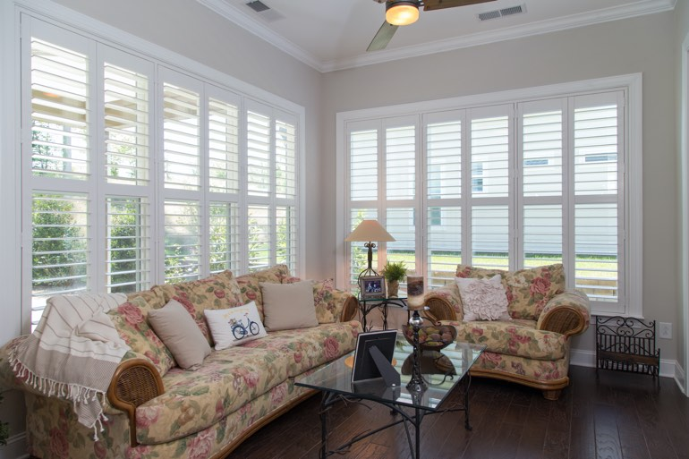 Traditional sunroom with plantation shutters in Salt Lake City.