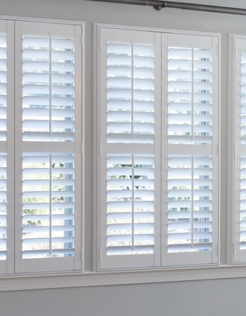 Hidden tilt rod shutters on Salt Lake City windows