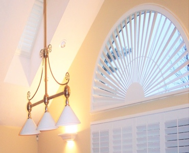 Salt Lake City arched eyebrow window with custom shutter
