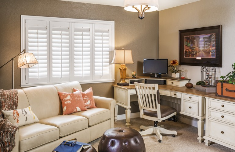 Salt Lake City home office with plantation window shutters.