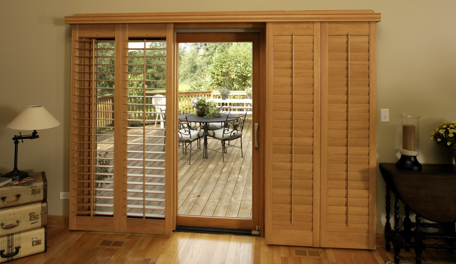 Bypass wood patio door shutters in Salt Lake City living room